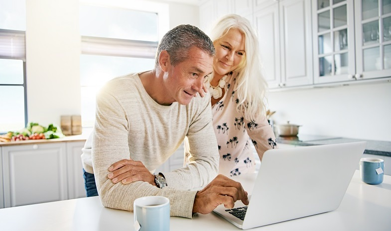 elderly-couple-checking-information-on-laptop
