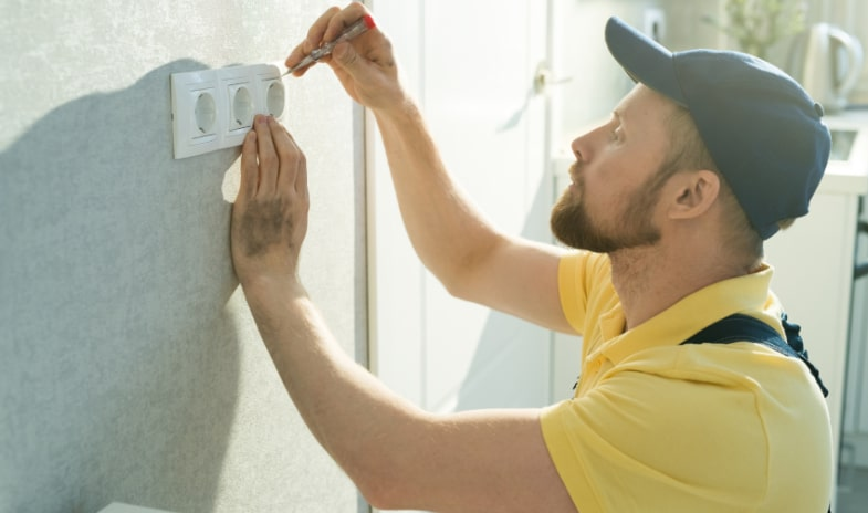Electrician Installing Types of Electrical Outlet Upgrades